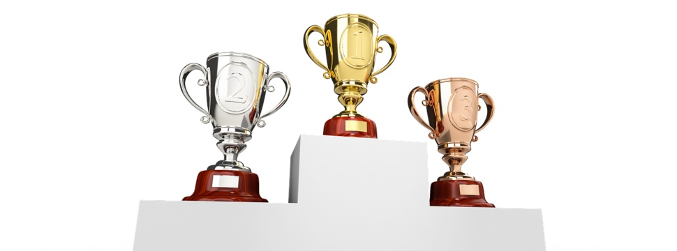 Bronze, silver and gold cups.